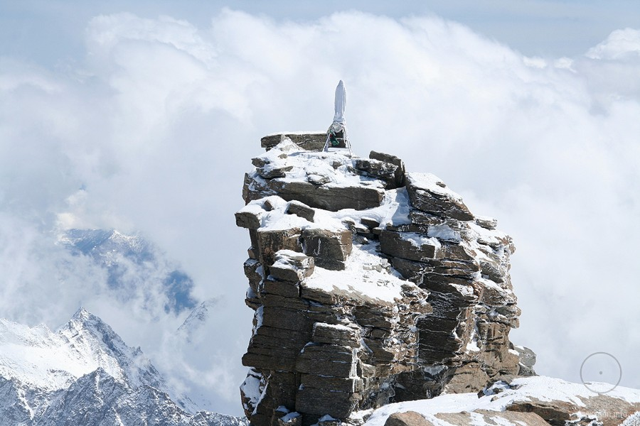 Virgin Mary figurine at the peak of Gran Paradiso, the Alps