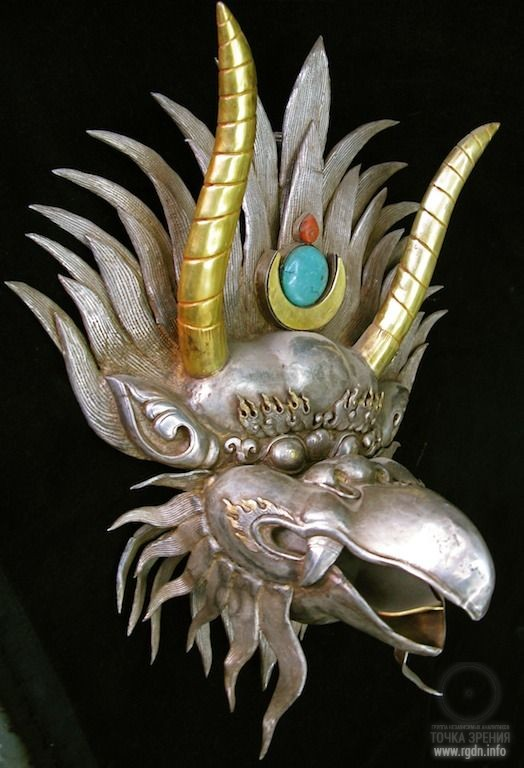 Sacred bird Garuda with the AllatRa sign