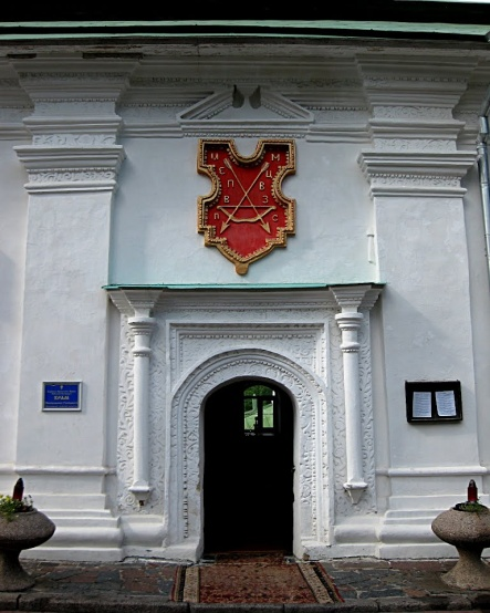 Coat of arms on the Refectory.